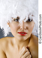 attractive woman wearing a white feather wig - closeup...