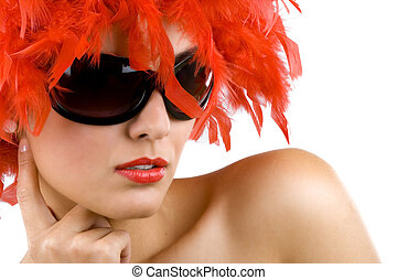 woman with red feather wig and sunglasses - closeup picture...