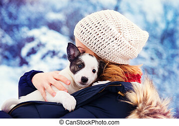 Woman in snow - Attractive young woman having fun outside in...