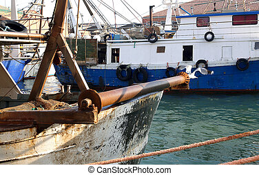 detail of Fishing vessel in sea haven moored in Italy -...