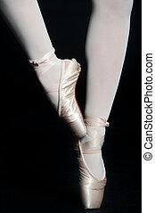 Ballerina Legs - A pair of slender ballerina legs on tip toe...