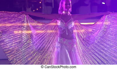 blonde girl dances belly dance - young blonde girl wearing...