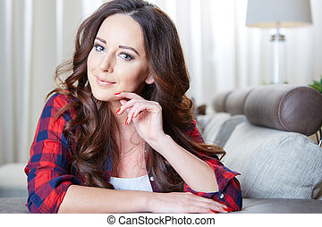 Relaxing woman sitting comfortable in sofa lounge chair...