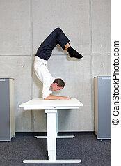man in scorpion asana - fit,flexible business man in...