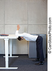 office yoga - man exercising - office yoga - business man...