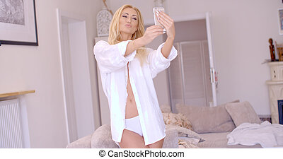 Sexy Blond Woman in White Taking Selfie - Pretty Sexy Blond...