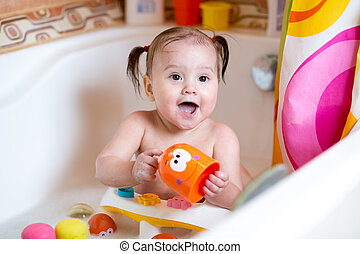 funny baby smiling while taking a bath - funny toddler baby...