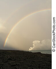 Rainbow over lava flow of Maunakea volcano, Big island,...