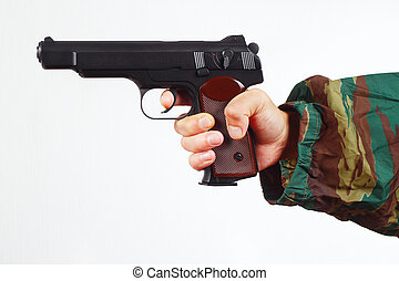 Hand in camouflage uniform with army gun on white background...