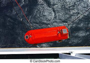 lifeboat - lowering of a lifeboat during a drill on a ship