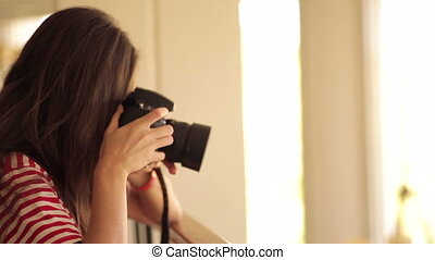 Young girl taking a pic with camera