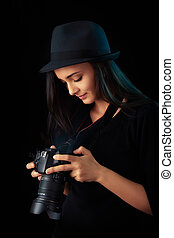 Young photographer girl with DSLR - Portrait of a cool girl...