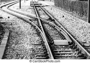 Train tracks and points in black and white.