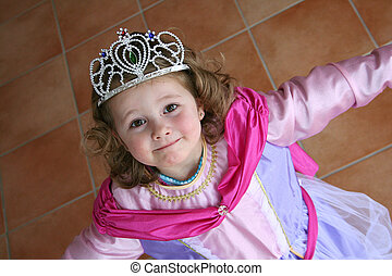 little princess in nice clothes is looking very happy
