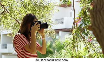 girl walking in the park and take pictures
