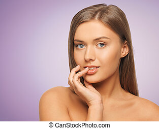 beautiful young woman touching her lips - beauty, people and...