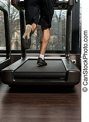 Fitness Man Running On Treadmill - Close Up Of Male Legs...