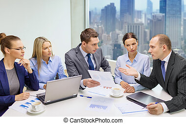 business team with laptop and papers meeting - business,...