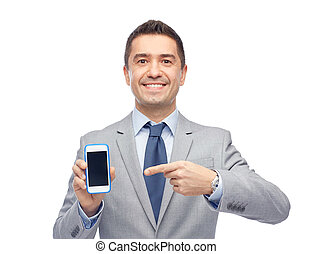 happy businessman showing smartphone screen - business,...