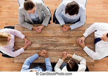 close up of business team sitting at table - business,...