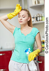 tired woman cleaning home kitchen - people, housework and...