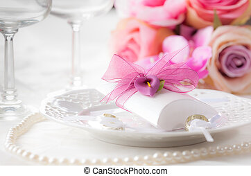 Wedding place setting with small present for guests