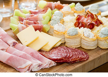 Meat and Fruit Appetizers - An assortment of appetizers made...