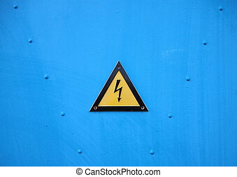 Yellow Electrical Warning Triangle Sign on Blue Background