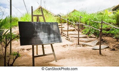 chalk board at tropical island with nature background -...