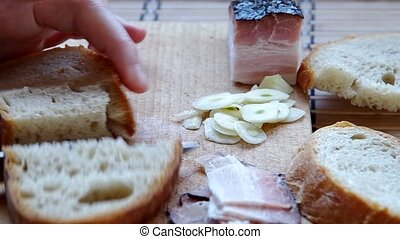 Slicing bread - Prepare breakfast, bread with bacon
