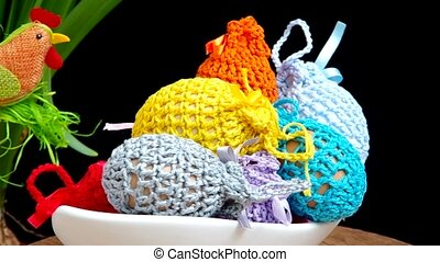 Easter decoration, crocheted eggs are rotated on the table