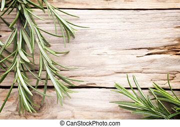 Rosemary. - Rosemary twig on the wooden background.