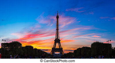 Eiffel Tower at sunset in Paris - PARIS, FRANCE - JULY 14...