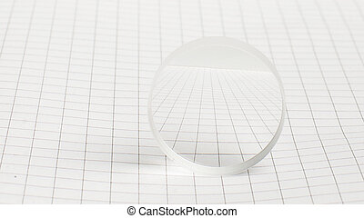 Optical lens on the school notebook - Optical instrument...