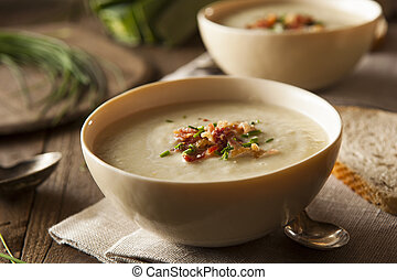 Homemade Creamy Potato and Leek Soup in a Bowl