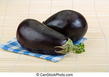 Aubergine - Ripe aubergine - on the wood background