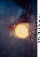 Porch Light in Snow Storm - Porch light with soft focus in a...