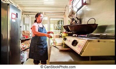 women cooking in outdoor kitchen in - industrial kitchen in...