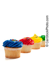 Assorted cupcakes on a white background