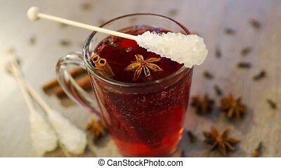 Mulled wine in a mug with clove, cinnamon and anise - Studio...