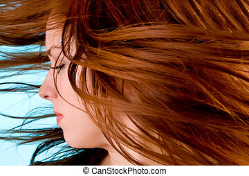 Hair in a Swirling Wind - Womans hair are being blown away...