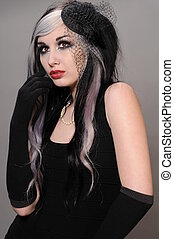 Goth girl - Pretty girl with goth hair in a vintage black...
