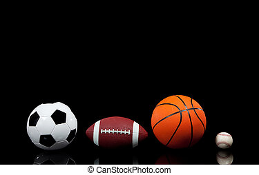 Sports balls on a black background - Multi sports balls on a...