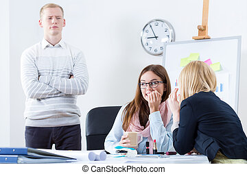 Gossip in the office - Horizontal view of gossip in the...