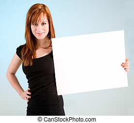 Young Redhead Woman Holding a Blank White Sign - A beautiful...