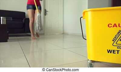 Woman Chores Cleaning Floor - Young woman wiping floor with...