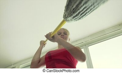 Low Angle Woman Cleaning Floor - Young woman wiping floor...