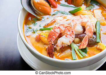 Tom yum soup ,Tom yam is a spicy clear soup typical in...