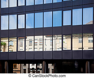Old building architecture reflected in modern building