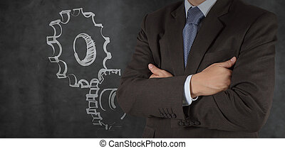 smart businessman with gear to success concept
